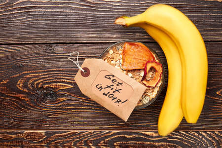 staying fit: Bananas and portion of muesli. Staying healthy with nutrition. Stock Photo