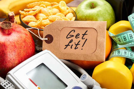 difficult lives: Tonometer, label, dumbbells and fruits. Key to a healthy life. Stock Photo