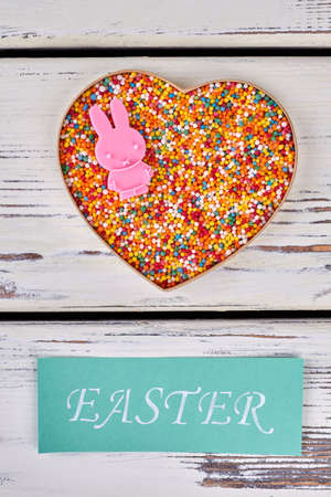 Sugar sprinkles and Easter card. Sweets in heart box. Stock Photo