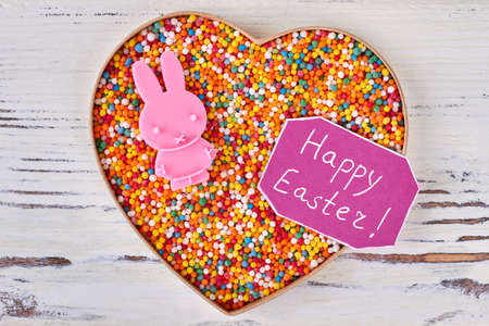 Gift for girlfriend images stock pictures royalty free gift for sweets and happy easter card heart box on wooden background easter gift for girlfriend negle Image collections