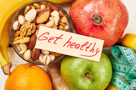 Nuts in bowl and fruits. Reasons to get fit.