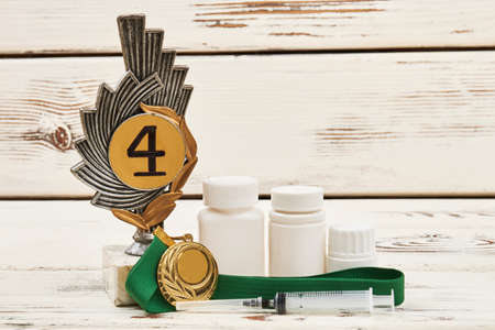 reason: Medals and drugs on wood. Conference on doping in sport.