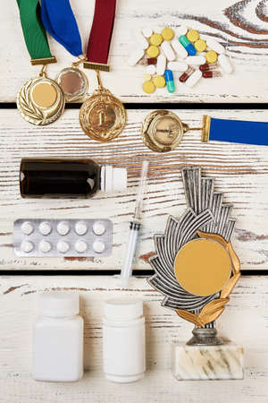 Awards and drugs. Modern sport: victory with doping. Stock Photo