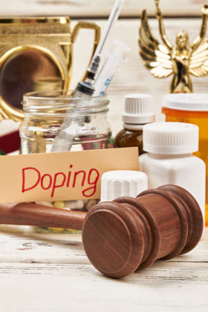 Hammer, award and pills. Criminal responsibility for doping.