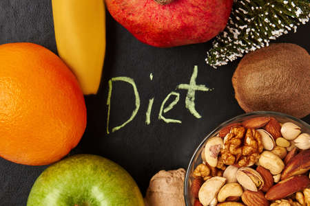 reason: Organic food on black surface. Develop your motivation. Stock Photo