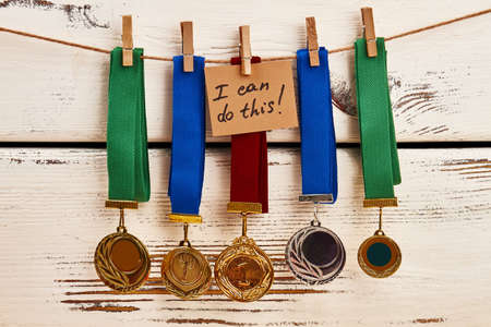 Medals on clothesline. I can do this. Stok Fotoğraf