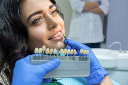 Patient And Tooth Color Chart Young Woman Smiling Effective