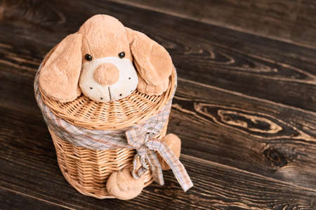 Willow basket with soft toy. Laundry basket with lid. Home crafts ideas.