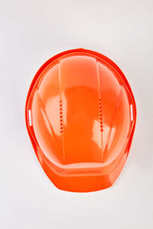 Orange safety helmet isolated. Accident protection hat on white background. Be in safe. Stock Photo
