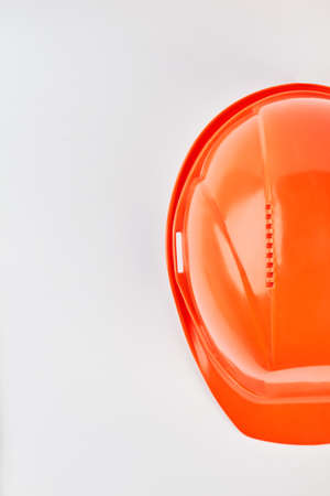 Image of plastic safety helmet. Professional builder hat on white background. Stock Photo