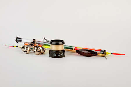 bobber: Black spool, floats, fishing bells. Gear accessories for fisherman. Stock Photo