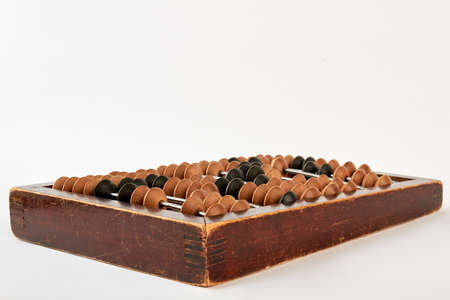 Bookkeeping abacus on white background. Computing of savings. Vintage calculating accessory.