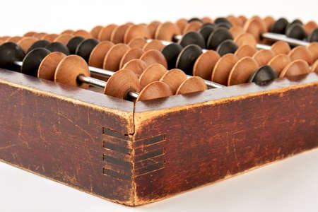 educating: Old wooden scratched abacus. Retro accounting abacus, white background.