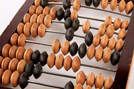 Antique wooden abacus. Old retro calculator. Money and poverty.