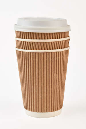 junkfood: Paper cup take out coffee. Brown paper cup close up. Take coffe with you.