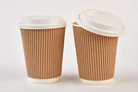 Ripple paper cups, one opened. Takeaway cups of coffee.