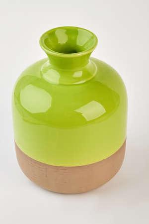 Two-tone shiny vase isolated. Elegant ceramic vase, white background. Trendy pottery at home. Stock Photo