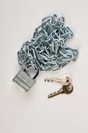 enclose: Metallic chain, lock and keys. Security equipment on white background.