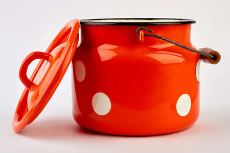 Blank kitchen pot with lid. Cooking jug for liquid, white background. Preparation for dinner.