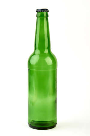 Close up of empty glass bottle. Clear beer bottle, white background.