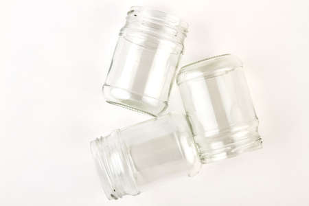 Several transparent glass jars opened. Glass industry for canning.