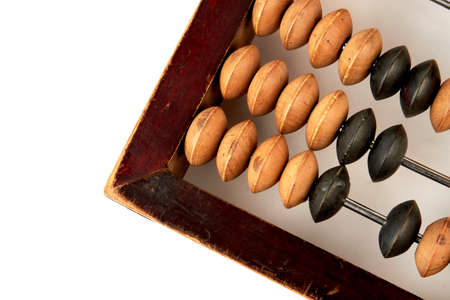 Cropped picture of wooden abacus. Vintage money calculator, white background.