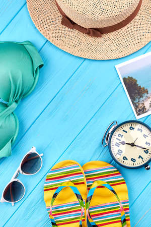 Vertical background from beach accessories. Woman summer clothing on sea background.