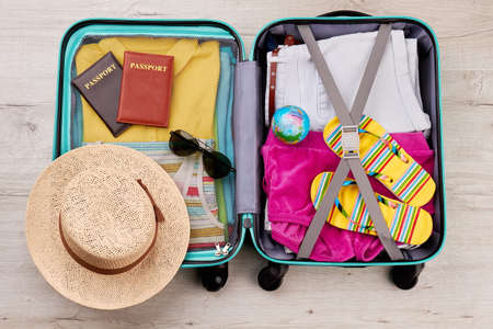 velure: Tourist travel bag full of clothing. Essential summer stuff for positive leisure.