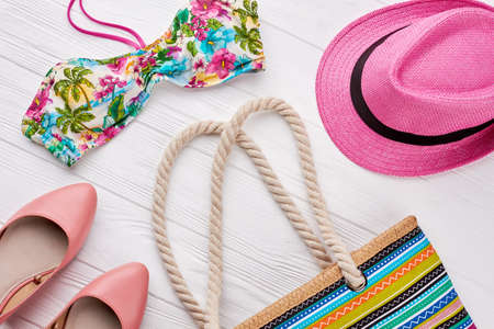 Collection of women beach accessories. Summer fashion look, wooden background. Stock Photo