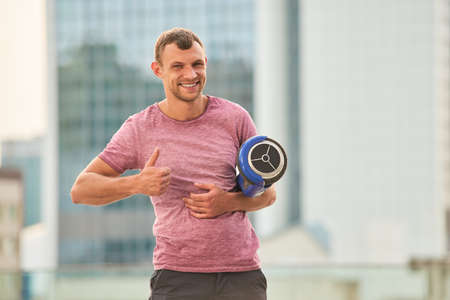 hover: Man holding hoverboard and smiling. Guy showing thumb up. Make your trips easy. Stock Photo