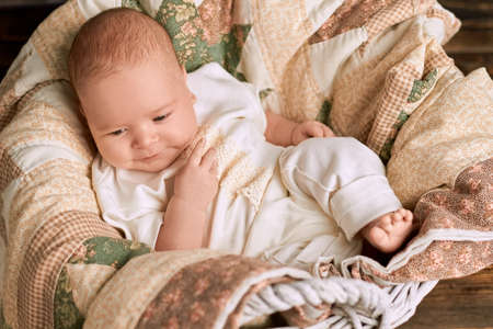 Small kid and blanket. Cute infant boy. Stock Photo