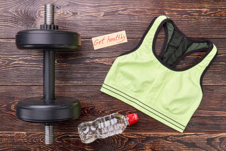 get a workout: Get healthy with dumbbells lifting. Athletic body and sporty shape. Women in sports.