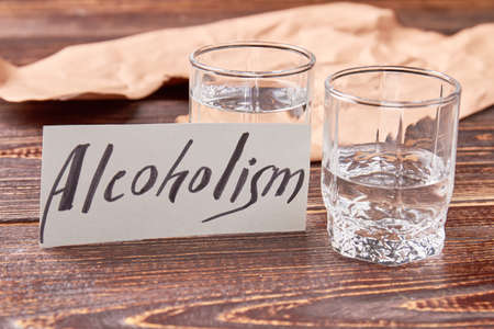 Alcohol dependence concept. Harmful habit to drink alcohol leads to problems with health. Stock Photo