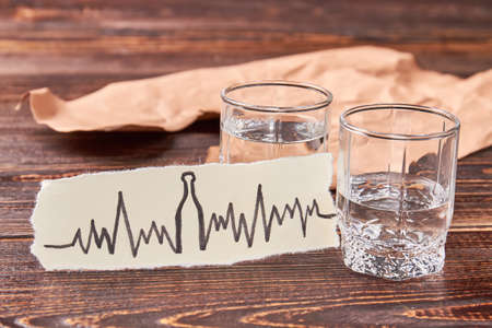 Heart illness as result of alcoholism. Tachycardia, heart problems and alcohol addiction. Stock Photo