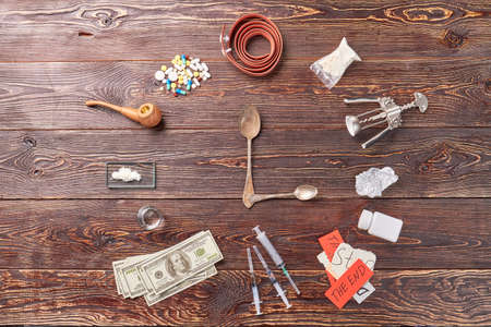 foil: Still life of narcotic preparations. Image of clock from drugs.