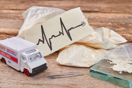 Narcotics overdose and emergency ambulance. Drugs addiction leads to problem with heart.