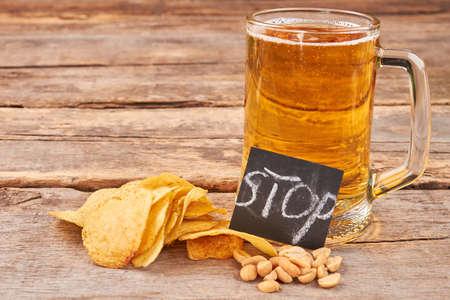 gastro: Rustic beer background. How to stop beer drunkenness.