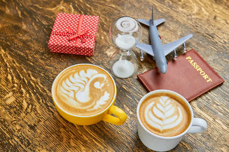 Coffee, present and hourglass. Passport and toy plane. How to get visa faster.