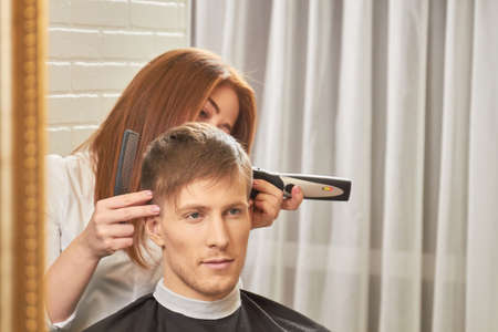 appliances: Man getting haircut. Barber, comb and hair clipper. Stock Photo