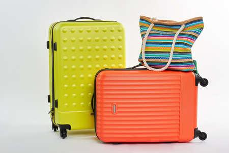 Large wheeled suitcases, handbag. Colorful textile bag on luggage. Stock Photo