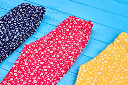 Casual summer cotton girl trousers. Collection of colorful summer pants for small girls close up.