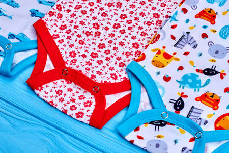Detail of organic bodysuits for newborn. Modern brand cotton baby rompers close up. Infant child natural summer wear.