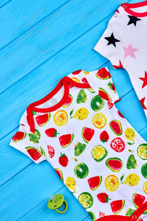 romper: Infant baby modern cotton rompers. Fruit print beautiful bodysuit for newborn, pacifier, top view.