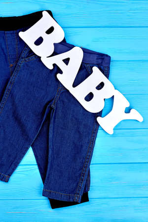 Baby jean attire on sale. Collection of denim apparel for infant kids. Shop online high quality jeans for child. Stock Photo