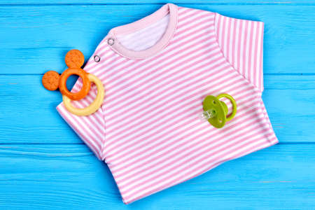 romper: Cotton striped shirt for baby-girl. New brand cotoon bodysuit and accessories for baby-girl, top view. Natural soft clothes for kids on sale.