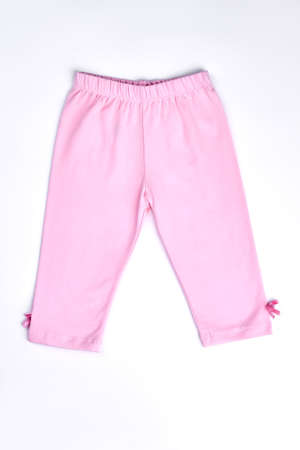 Baby-girl cotton pink capri. New light pink pants with bows for toddler girl isolated on white background.