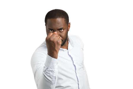 Aggressive black businessman shaking fist. Angry businessman shaking fist on white background. Irritated dark skinned businessman.