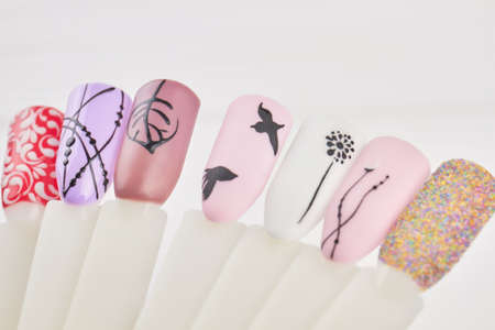 Fashion nail art design for beauty salon. Nails art palette on white background close up. Design templates for beauty salon. Stock Photo