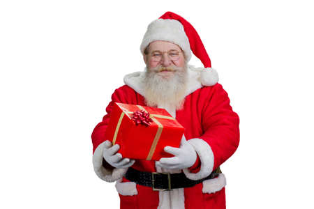 newyear: Santa Claus holding red box with present. Portrait of kind authentic Santa Claus holding Christmas gift on white background, studio shot. Stock Photo