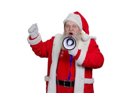 Bearded Santa Claus shouting in megaphone. Studio shot of Santa Claus loudly speaking in megaphone, white background. Santa Claus talking in megaphone, close up portrait. Stock Photo
